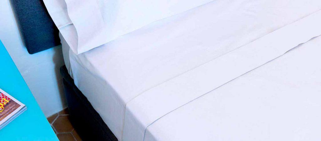 dormir draps blancs